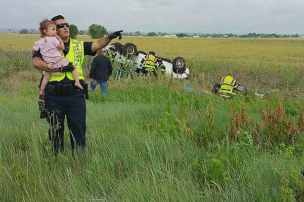 Colorado-officer-comforts-child-after-fatal-crash
