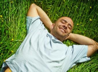 carefree-man-laying-in-grass-iStock-2x3