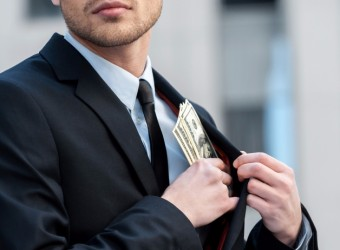20151124143042-man-money-pocket-stealing-embezzlement-investors-businessman-financial-wealth-worker-dishonesty-criminal-currency-dollar