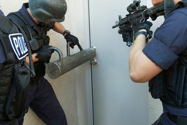 Police-officers-breaking-down-doors