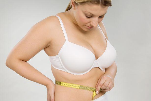 A-woman-measuring-her-waist